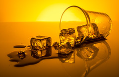ice (Albert N Lewis) Tags: ice drink whiskey glass product commercial food spill liquid orange amber tabletop artistic advertising icecube bar colorsinourworld golden brilliant frozenintime
