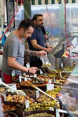 The Olive Merchant (pupuplatter85) Tags: olives outdoor market vendor travel