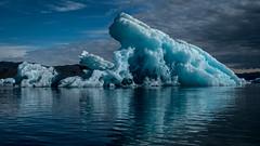 A frozen wave (Frank Busch) Tags: frankbuschphotography imagebyfrankbusch photobyfrankbusch blueice frozenwave greenland ice iceberg kayaking kayaks ocean reflection southgreenland wave waveglacier wwwfrankbuschname
