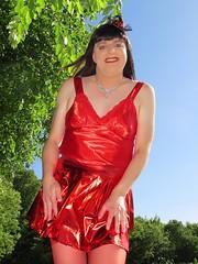 Smile (Paula Satijn) Tags: sexy hot girl gurl tgirl tranny transvestite red skirt dress silk silky satin shiny summer outside sunshine happy smile hat fascinator miniskirt