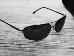 sunglases (tobsest) Tags: sunglases sonnenbrille tisch schwarz weiss brille holz wood table
