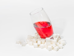 Sugar with a dash of fizzy drink.... (Ian Johnston LRPS) Tags: red strawberry drink fizzy sugar cubes ongrey sweet glass d800 strobes flash spotlight