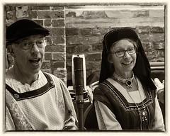 Synchronised Smiling (Reinardina) Tags: southampton england tudorhousemuseum heritageday people candid monochrome blackandwhite couple tudordress smile two sepia framed portrait