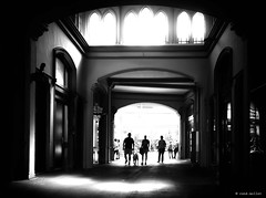 The three and a half ... (Ren Mollet) Tags: artgoldau station street streetphotography shadow silhouette sbb hall threeandhalf windows passage people pen penf zuiko renmollet light blackandwhite bw