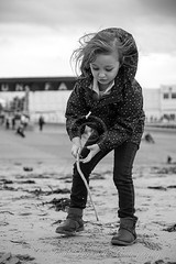 Sand Writing (slaup) Tags: niamh child infant girl beach playing sand writing stick blackpool chilly photography candid portrait