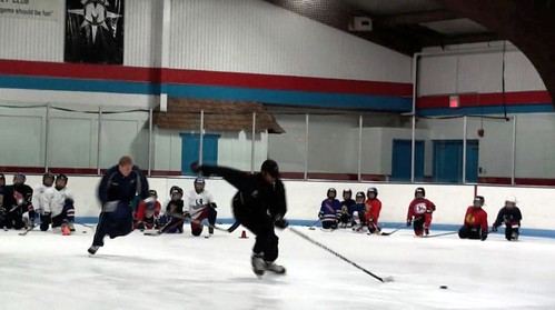 Brad Perry demonstrating hockey quick starts at a hockey camp