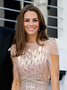 Catherine, Duchess of Cambridge aka Kate Middleton wears a dress by British designer Jenny Packham as she attends the 10th Annual ARK (Absolute Return for Kids) Gala Dinner at Kensington Palace. It is the Duke and Duchess's first official public engagement since their wedding. London, England