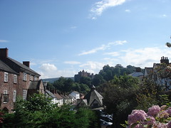 Dunster (~~Paddy~~) Tags: camera uk flowers blue trees england sky west castle buildings town photo with cloudy sony south taken somerset historic yesterday dsc dunster w30 flickraward me2youphotographylevel1