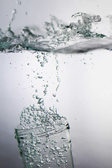 the surfer (redbeanicy) Tags: white motion water glass canon frozen droplets movement waves surfer bubbles drop freeze figure jar splash dslr splatter highspeed