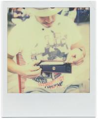 Loading Film (Thomas Boesgaard) Tags: boy man male copenhagen denmark europa europe skandinavien zealand tip scandinavia danmark kbenhavn sjlland skuespilhuset koebenhavn colorshade px70 theimpossibleproject px70colorshade silviopereira cafeofelia