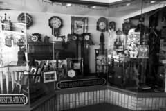 Kingston Store Window (yogagi) Tags: kingstonny blackandwhite monochrome sony rx100m3 adobecameraraw photoshopcc2015 store window shop clocks reflection