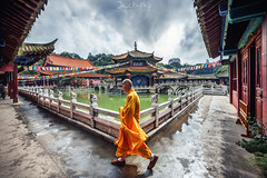 The Monk (daniele.boffelli) Tags: cina monk buddhism temple travel travelling summer asia china kunming yunnan weather orange color colors