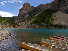 Canoes at Moraine Lake-Alberta CA (moelynphotos) Tags: morainelake lake glaciallake canoes dock boats glacial silt peaks mountains alberta banffnationalpark nationalpark canada beautyinnature blue scenics landscape touristdestination outdoors boating nobody landscapeformat watersedge lakeshore moelynphotos