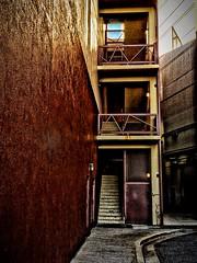 A walk in an inner city.... (tomk630) Tags: maryland foreboding darkness light sundown passageway usa urban