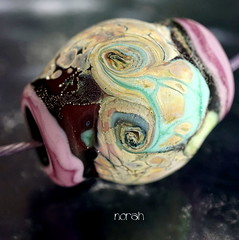 Norah (Laura Blanck Openstudio) Tags: openstudio openstudiobeads glass hadmade lampwork beads single focal bead necklace pendant jewelry big holes choker murano whimsical funky odd abstract asymmetric colorful multicolor nugget rock pebble stone wearable faceted made usa fine artsartisan artist winner show published festival transparent frit lilac lavender violet grape purple plum raku silvered silver leaf green aqua turquoise blue ocher sand beige almond ruby deep opaque glow matte etched frosted burgundy maroon wine bordeaux