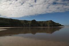 Balance (Julian Pett) Tags: blue sea cliff cloud reflection beach rock wales gold bay sand head great cymru gower worms peninsula orm orme rhossili