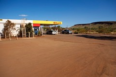 Fuel Station at Tom Price (huskyte77) Tags: road city trip travel november blue shadow red vacation sky orange brown mountain building tree nature car station weather sign yellow price architecture tom clouds canon landscape eos bush sand flickr track day view desert action outdoor oz parking shell lot australia center clear pump dirt heat outback gps aussie camper range westernaustralia fuel gravel centralroa