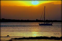 ... il calore del Salento (FranK.Dip) Tags: desktop sunset wallpaper italy costa barca italia tramonto mare vela riflessi salento puglia nord brindisi riflesso sfondo sfondi spettacolare frankdip panoramafotogrfico