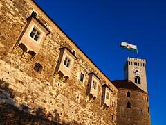 The Castle (Union*) Tags: city blue sky tower castle modern flag medieval ljubljana styles outlook baroque grad blend ljubljanski