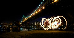 A Night on the River (DPGold Photos) Tags: city nyc newyorkcity longexposure bridge ny newyork night river fire lights cityscape nightscape manhattan manhattanbridge eastriver lighttrails firedancer dpgoldphotos