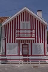 Striped Houses (Amrico Aperta) Tags: city cidade portugal cores wooden seaside raw colours bright stripes riscas litoral madeira beiramar aveiro palheiros listas costanova brilhante stripedhouses casassriscas panasonicdmcgf1 amricoaperta