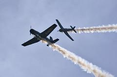 Crossover (prajpix) Tags: yak sky clouds plane airplane scotland fly flying highlands display aircraft aviation smoke formation propellor aerobatics belladrum monoplane nanchangcj6a