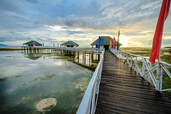 Houses On Stilts (julesnene) Tags: travel sunset dusk hut kubo lowtide batangas stilts seagrass calatagan wideangleshot canoneos7d julesnene juliasumangil