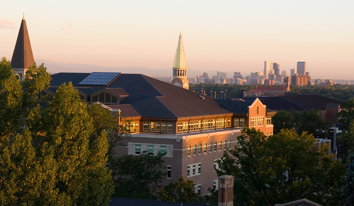 The campus at sunrise, with downtown Denver in the background.