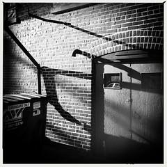 (Joie de Vivre) Tags: door shadow blackandwhite brick wall dumpster pipe iphone hipstamatic