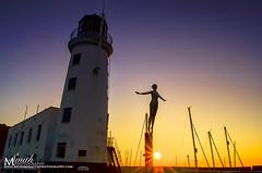 Scarborough Lighthouse sunrise (MichikoSmith) Tags: uk sea summer england lighthouse fish water girl statue sunrise gold golden boat town seaside fishing fisherman outdoor yorkshire north hour scarborough landscpae