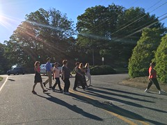 The group takes off on an early morning wellness walk.