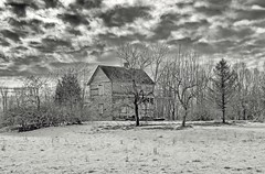 Boarded up (shannon4462) Tags: boardedup oncewashome farmhouse bw landscape snow contrast clouds sky