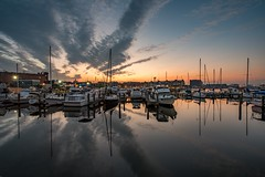 Lovely Morning (Isaac Guerrero) Tags: longexposure calmwater morning reflections sunrise baltimore harbor boats