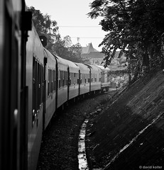Out of Hanoi (davidkoiter) Tags: travel urban bw white black car turn train canon eos track bend vietnam 7d l series desaturated curve hanoi distance 70200 f4 2012 f4l koiter davidkoiter