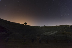 same old show [explored 25th July 2012 #63] (ChrisBrn) Tags: light sky tree silhouette night stars ancient theater greece subtle lightpollution dodona subtlelight ancienttheater dodoni