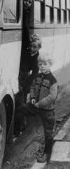 Off to School (theirhistory) Tags: road street uk school boy bus coach village child journey junior gb jumper wellies primary longtrousers