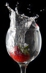 Strawberry Splash (Andy Kent 100) Tags: life camera andy water glass fruit canon kent still strawberry wine action flash andrew off photographic freeze society speedlight f28 slpash bromsgrove strobist akphotographic wwwakphotographiccouk ankent100 andykent100hotmailcom