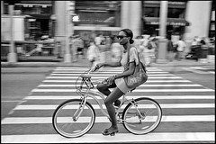 un ange passe (paga4flickr) Tags: street bw newyork film sunglasses bike bicycle 35mm noiretblanc candid nb stunning belle mp delta100 rue bicyclette summilux velo vlo vlos ddx 24x36 ilfotec file