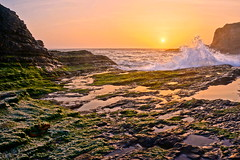 Panther Beach (mattbroadwin) Tags: ocean california santa sunset sky sun reflection beach nature clouds bay rocks wave cruz area davenport panther