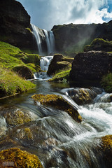 At Snfellsnes (Jokull) Tags: water grass clouds river island photo waterfall iceland rocks photograph lee vegetation flowing icelandic traveltoiceland canoneos5dmkii zeissdistagont2821ze onephotomonthaugust cometoiceland