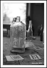 Time In A Bottle - Bunker House Britannia Shipyard 8515e (Harris Hui (in search of light)) Tags: bw stilllife canada vancouver cards blackwhite lyrics bottle fuji dof bc drink bokeh song drinking richmond whisky fujifilm digitalbw goldies s3pro lovesong jimcroce standardlens timeinabottle britanniashipyard fujis3pro nikon35mmf18 bunkerhouse