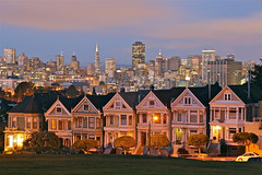 Alamo Square at Night (AJ Brustein) Tags: california park ca street city travel blue light red sky urban cloud house green fountain up grass skyline vw night sisters skyscraper canon buildings square aj lights evening san francisco stream long exposure downtown cityscape view streak mark postcard iii famous tail hill beetle victorian visit headlights tourist fran seven jungle fullhouse shutter 5d bluehour lit transamerica alamo iconic cliche volkswagon paintedladies brustein 5dm3