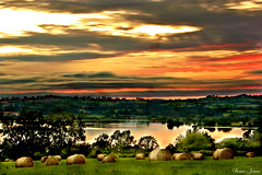 Haybales at Sunset (Karen James) Tags: trees sunset sky colour reflection nature wales clouds geotagged kj haybales