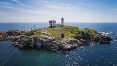 Nubble Lighthouse (Aaron Mello Photography) Tags: ocean new york travel sea summer england lighthouse seascape water clouds island maine phantom drone nubble downeast dji