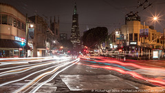 Columbus and Stockton (DSC03359) (Michael.Lee.Pics.NYC) Tags: sanfrancisco longexposure night sony lighttrails transamericapyramid traffictrails columbusavenue stocktonstreet buscables a7rm2 voigtlandernoktonclass35mmscf14