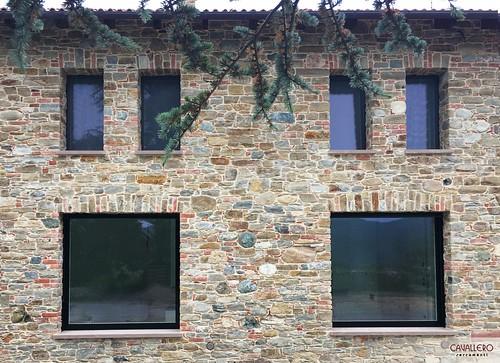 Serramenti Legno-Alluminio a scomparsa con vetro strutturale