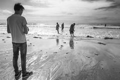 Standing by the sea (Ludo_Jacobs) Tags: sea france coast beach people monochrome blackandwhite street streetphotography