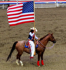 Flag bearer (Hayseed52) Tags: american flag horse girl cowgirl rodeo cody wyoming arena