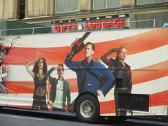 Evil Dead Double Decker Bus 5282 (Brechtbug) Tags: evil dead double decker bus billboard movie poster near 40th street 8th ave horror scary scifi film billboards new york city 2016 nyc science fiction red gold cities 09142016 starz explosions monsters book necronomicon lobby standee theatre sam raimi or bruce campbell st avenue chainsaw midtown manhattan ash vs
