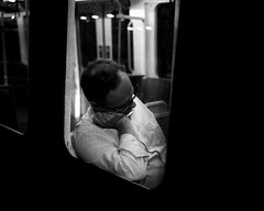 A Man Asleep On The Metro - Pelaw (Richard James Palmer) Tags: mamiya7ii mamiya 7ii 80mm ilford hp5 ilfordmicrophen microphen ishootfilm shoot film iso ilfordhp5 f4 newcastle northeast north east street photography streetphotography portrait black white rangefinder medium format 120 filmisnotdead analogue documentary epsonperfectionv700 epson v700 newcastleupontyne upon tyne tyneandwear northern uk england urban melancholy art fineart new overcast isolated walkabout 2016 gritty gloomy abstract trapped blackandwhite monochrome 160th pushed 3200 iso3200 3200iso